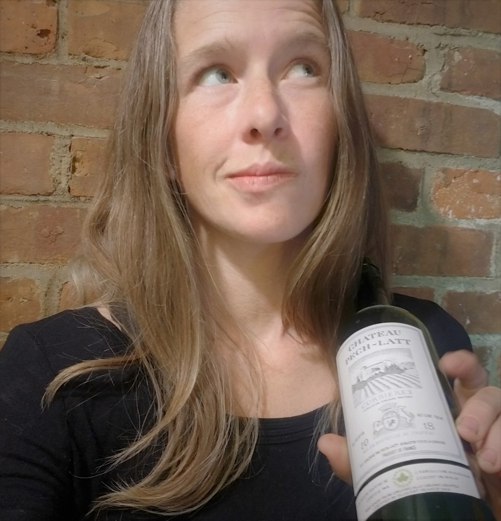 me, holding a bottle of my favorite US-available wine (Chateau Pech -Latt, Corbieres region) and contemplating my options.